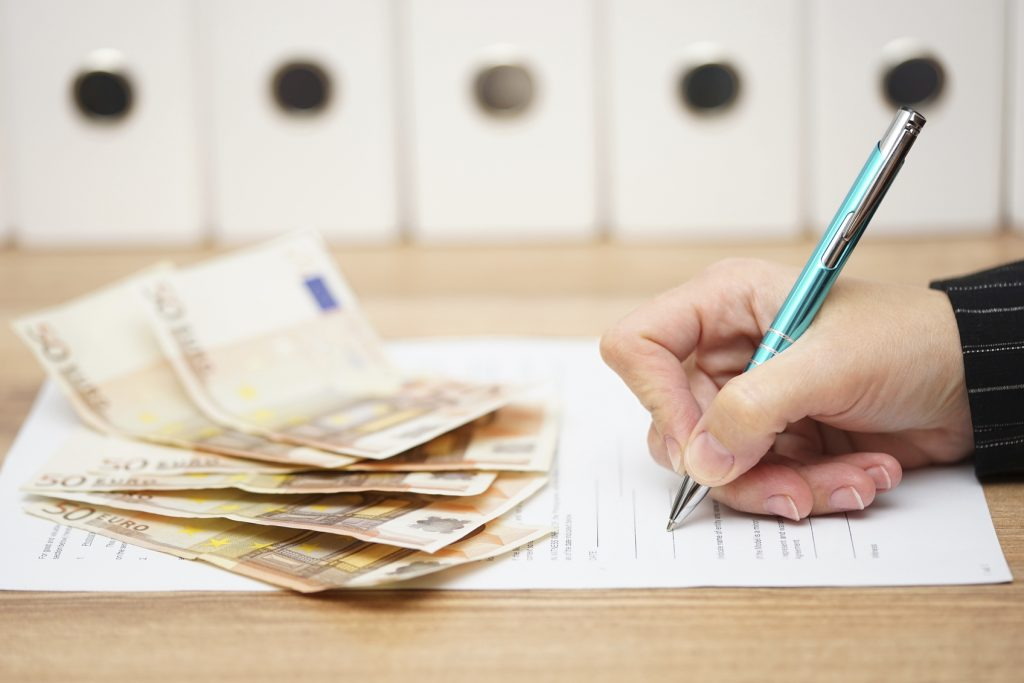 woman is signing contract to get a lot of money